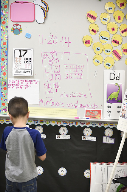 A child plays with a colorful dry erase board during National Education Association President Lily Eskelsen García's visit to Southwest Elementary school. Photo courtesy of the National Education Association.