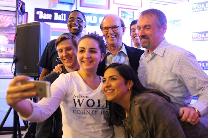 Bexar County Judge Nelson Wolff and supporters pose for a selfie on election night. Nov. 4, 2014. Photo by Scott Ball.