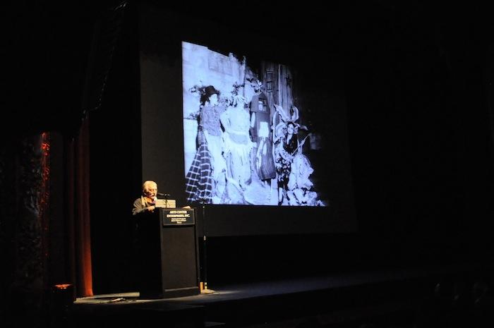 Ray Chavez takes the stage at PeckaKucha San Antonio Vol. 16. Photo by Iris Dimmick.