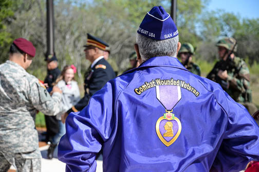 A guest at the wreath-laying ceremony wears a jacket signifying he has received the Purple Heart. Photo by Annette Crawford.