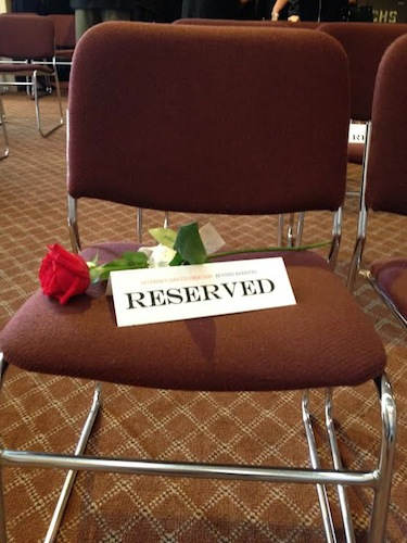 Seat reserved for fallen brothers and sisters serving the U.S. Military. Photo by Robert Rivard.