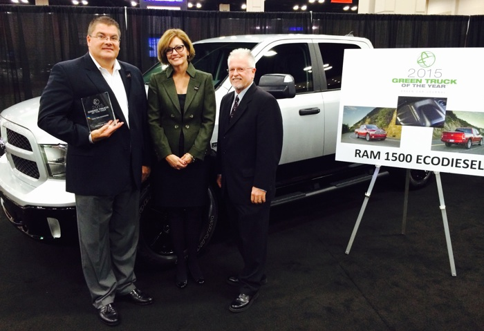 RAM Truck Brand President and CEO Bob Hegbloom, San Antonio Auto Dealers Association President Pam Crail, and Green Car Journal Editor and Publisher Ron Cogan stand after the presentation of the 2015 Green Truck of the Year award at the San Antonio Auto and Truck Show. Photo by Katherine Nickas.