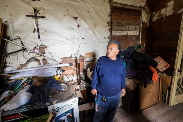 Miguel Calzada surveys the interior of his home. Photo courtesy David Bogle.