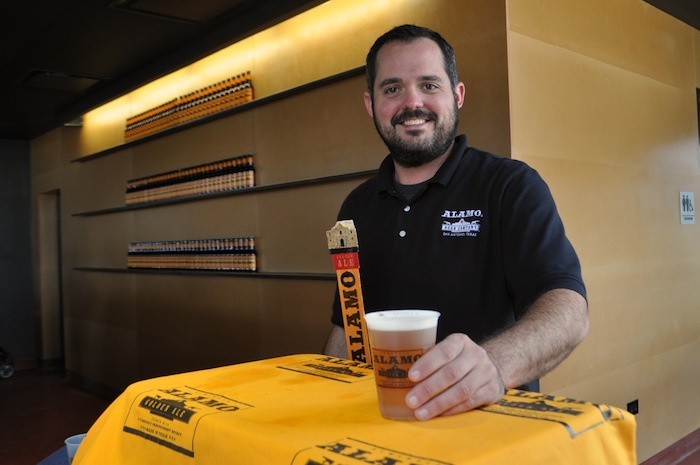 Zac Harris of Monks Toolbox serves up some Alamo Golden Ale during the brewery's ribbon cutting ceremony. Photo by Iris Dimmick.