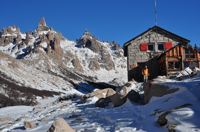 Cameron Redus walks out of Refugio Frey, a tiny mountain lodge at Cerro Catedral, Argentina. Photo by Everett Redus.