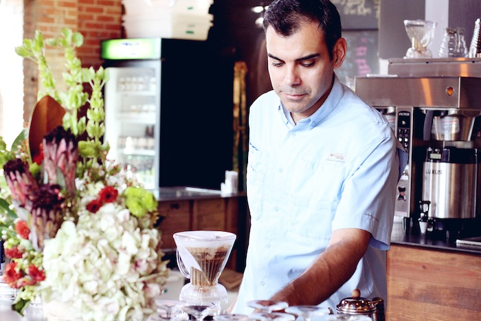 Charles Gonzalez makes a cup of coffee at Rosella. Photo by Brandy Rae Perez for Rosella Coffee Company.