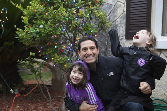Rep. Trey Martinez Fischer at home with his daughters Camilla, 4, and Francesca, 5 (right).