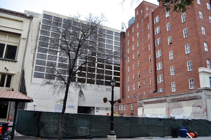 The empty lot next to the Maverick Building on Houston Street is slated to become a Hilton Garden Hotel. Photo by Iris Dimmick.