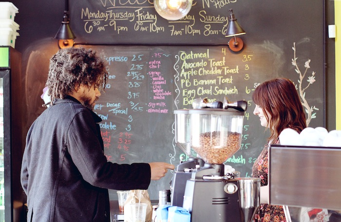 Rosella transaction. Photo by Brandy Rae Perez for Rosella Coffee Company.