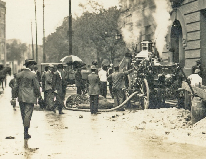 A steam fire engine pumps floodwaters from a downtown basement in San Antonio, October 1913. Historic photo courtesy of Lewis Fisher.