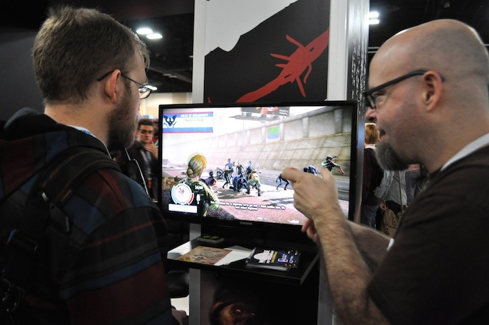 A gamer tries out a new zombie apocalypse game during PAX South. Photo by Iris Dimmick.