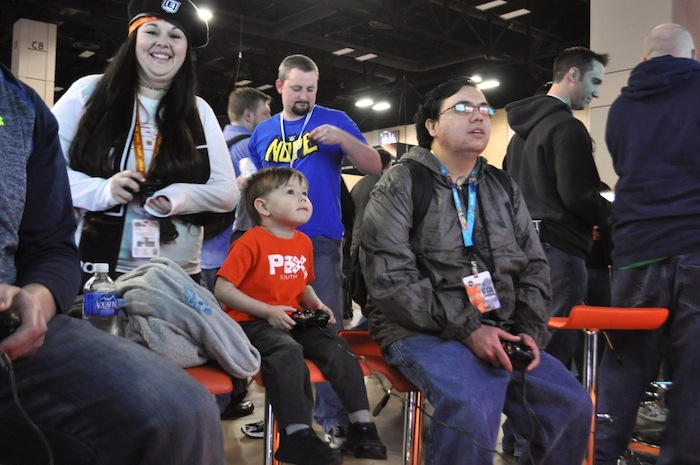 Christina Whitton (left) and her son, Alex, 3, try out new games during PAX South. Photo by Iris Dimmick.