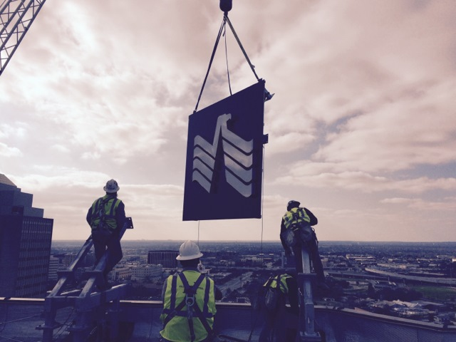 USAA's logo is installed on the top of One Riverwalk Place. Photo courtesy USAA.