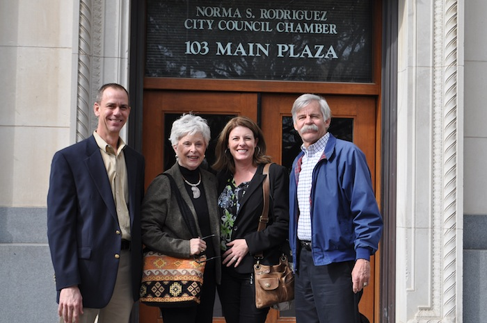 From left: Brooks Development Authority Environmental Manager Greg Hammer, former District 8 Councilmember Bonnie Conner, Green Spaces Alliance Executive Director Julia Murphy , and former Mayor Howard Peak pose for a photo after the aquifer and trailway programs were approved by City Council. Photo by Iris Dimmick.