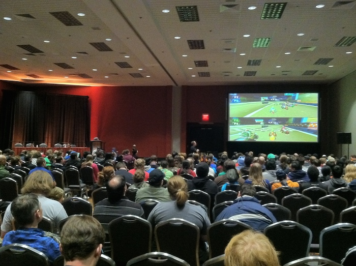 The first round of convention tournament Omegathon heats up in the Convention Center's Armadillo Theater. The Final Round of the tournament, which will end PAX on Sunday, involves a mystery video game challenge. Photo by Samuel Jensen.