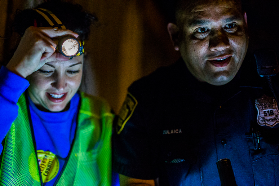Sara Pfeifer walks with a San Antonio Police officer during the point-in-time count of the local homeless population.