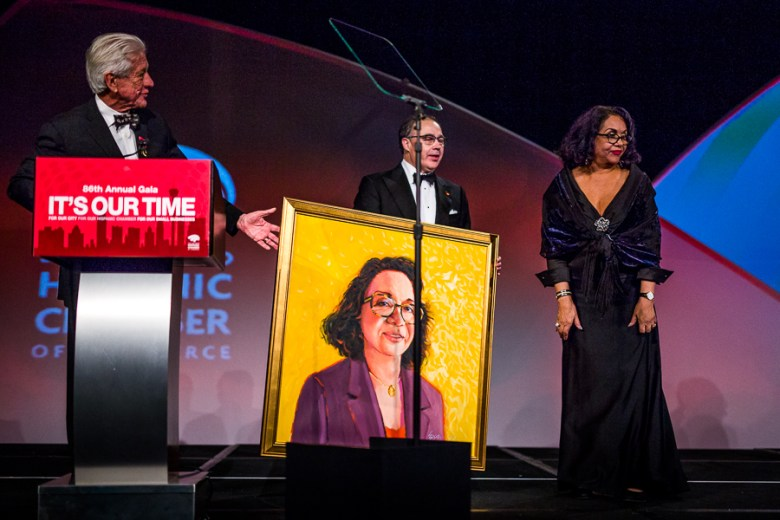 A portrait is presented to Patricia Pliego Stout at the 86th annual San Antonio Hispanic Chamber of Commerce gala. Photo by Scott Ball.