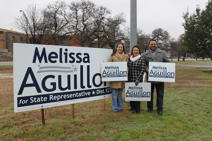 Texas House District 123 candidate Melissa Aguillon stands with supporters and campaign signs. Courtesy photo.