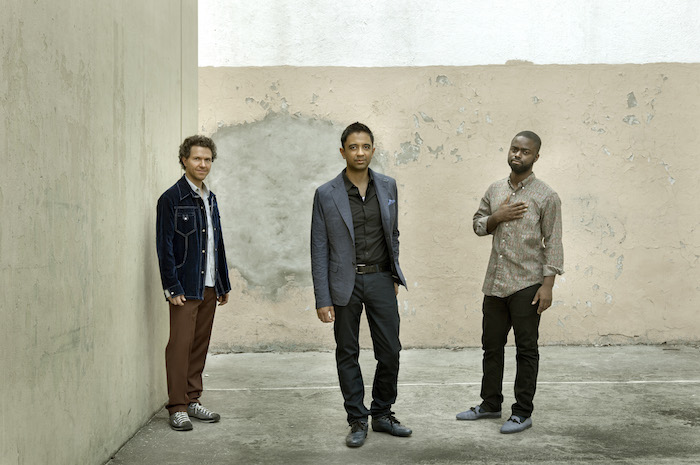 (Pictured from left): Bassist Stephan Crump, pianist Vijay Iyer, and drummer Marcus Gilmore form the critically acclaimed jazz trio. Image courtesy of Juan Hitters/ECM Records.