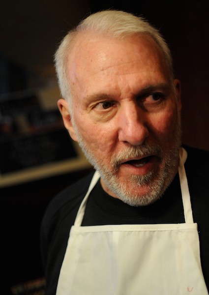 San Antonio Spurs Coach Gregg Popovich fields questions from the media prior to the Fourth Annual Champions Against Hunger Fundraising Dinner held at the The Grill in Leon Springs. Photo by Kristian Jaime.