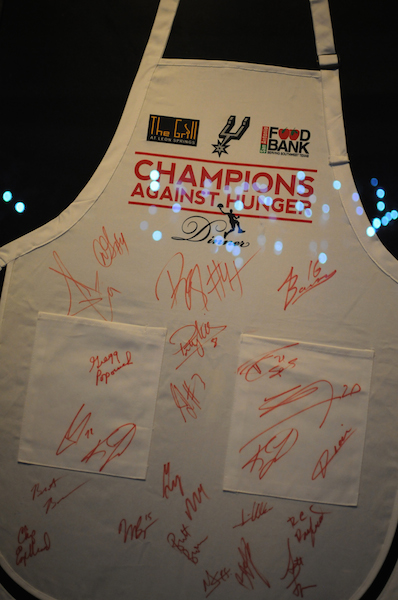 Aprons from the all-star San Antonio Spurs waiters adorn the walls at the The Grill in Leon Springs from past Champions Against Hunger Fundraising Dinner events. Photo by Kristian Jaime.