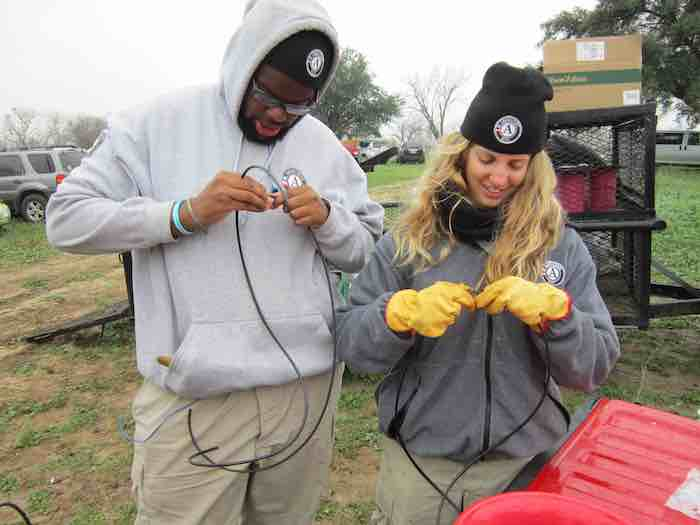 These volunteers came in from out of state. Gordon Swinton and Michelle Poulopoulos assembled drip irrigation lines as part of a six-week stint in San Antonio for Ameri-Corps, a national community service group of volunteers aged 18-24. Photo by Karen Stamm.
