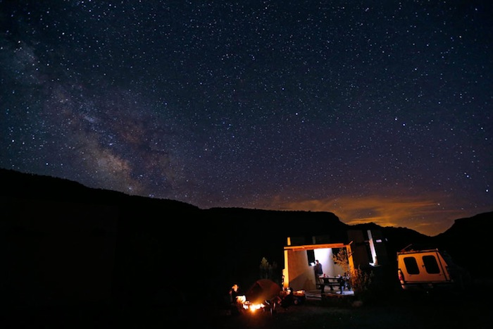 Light pollution from Albuquerque competes with the light of the Milky Way over a campsite along the Rio Grande in northern New Mexico. Photo by Erich Schlegel.