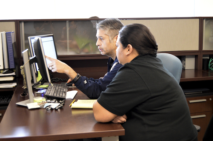 Two Webhead employs troubleshoot for a client. Photo courtesy of Webhead.
