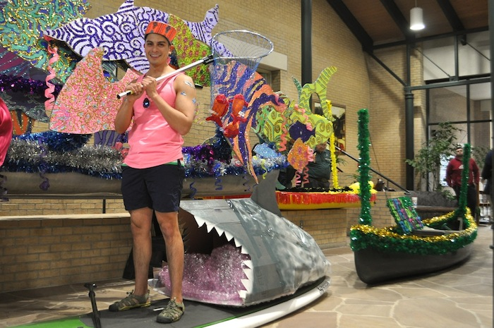 Ruben Gonzales, owner of SUPsatx, a local paddle board guided tour company, shows off his float for the inaugural Mission Reach Float Fest scheduled for April 11, 2015. Photo by Iris Dimmick.