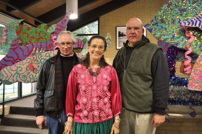 """Float builder and engineer Glenn Burt, artist Vicki Kinder, and artist Robert Wurzbach stand next to their float, """"A Fish Tale,"""" for the inaugural Mission Reach Float Fest scheduled for April 11, 2015. Photo by Iris Dimmick."""