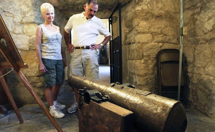 Visitors view restored cannon at the Alamo. Photo provided by San Jacinto Battleground Conservancy – SJBC.
