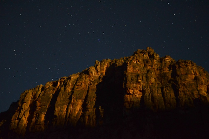 The stars shine bright as a cliff over the Rio Grande in the Lower Canyons of West Texas catches the first light of the rising moon. Photo by Jessica Lutz