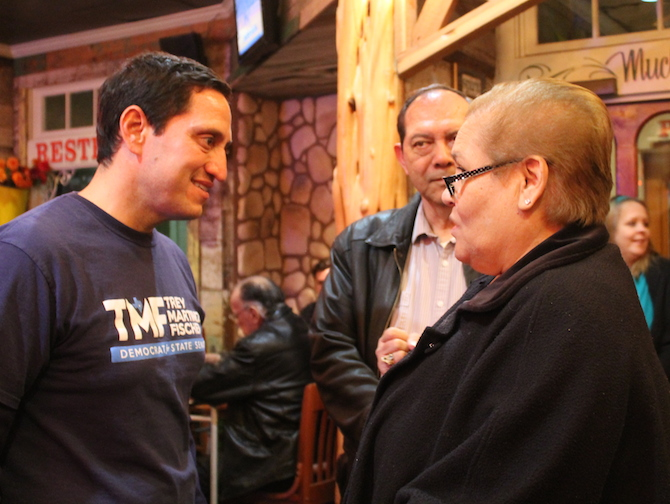 Trey Martinez Fischer speaks with a supporter during his special election watch party. Photo by Amanda Lozano.
