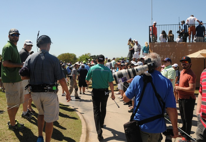 2015 Valero Texas Open Winner walks past fans and media during his final round at the JW Marriott TPC San Antonio. Photo by Kristian Jaime.
