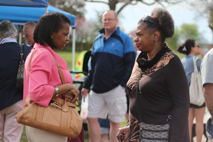 Mayor Ivy Taylor mingles with an attendee at the Dignowity Hill Farmer's Market on Sunday. Photo by Joan Vinson.