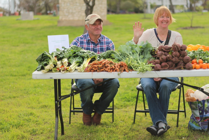 Sylvie Shurgot and Artudo Torres sell locally grown vegetables at the Dignowity Hill Farmer's Market.