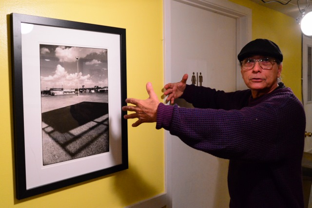 George Cisneros discusses one of Mike Greenberg's photos on exhibit at Urban 15. Photo by Page Graham.