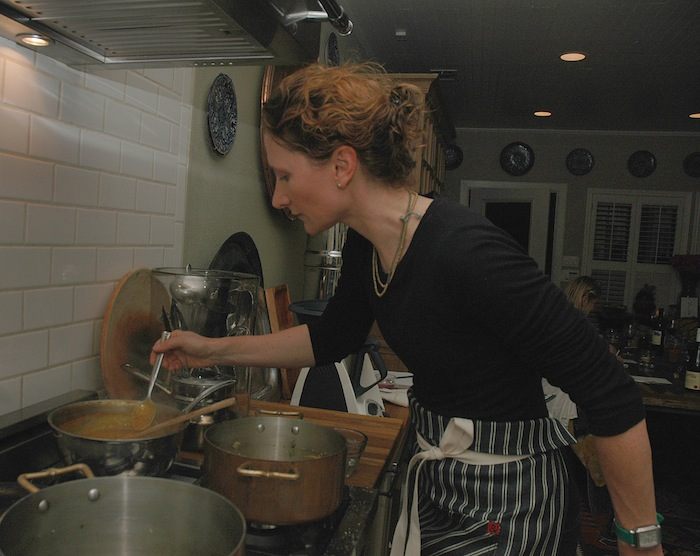 Elizabeth Johnson cooks up a meal during a recent pop-up dinner. Photo by Karla Held.