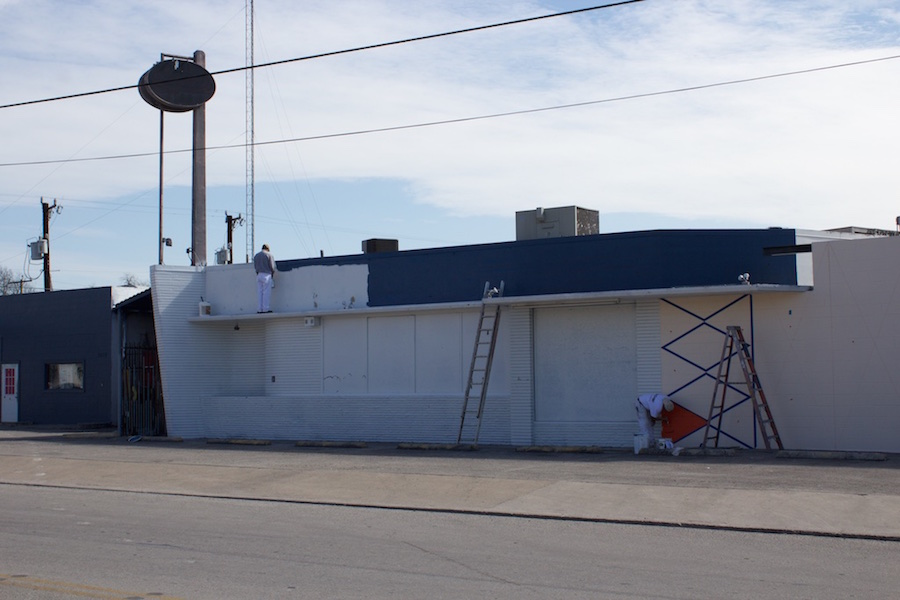Painters work on the Paper Tiger's façade on March 13, 2015. Photo by Hunter Bates.