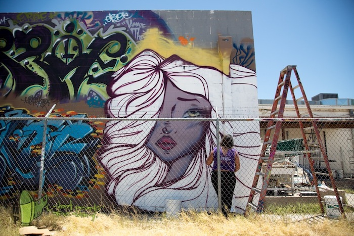 A wall mural by the artist Rabbit Rye. Her artwork often contains feminine characters. Photo by Jessica Martinez.