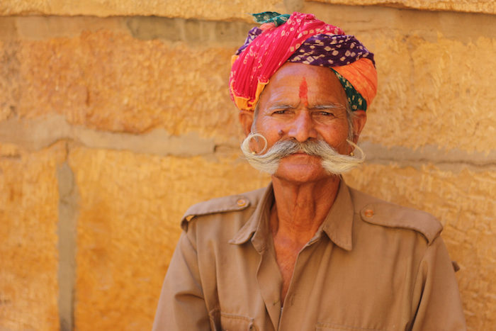 People in Jaisalmer, India, dressed in vibrant colors. Photo by Joan Vinson.