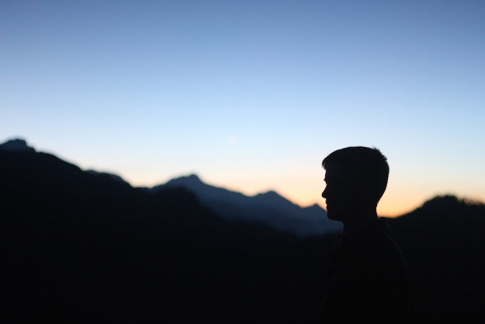A photo of my brother at sunrise while trekking the Annapurna Circuit in Nepal. Photo by Joan Vinson.