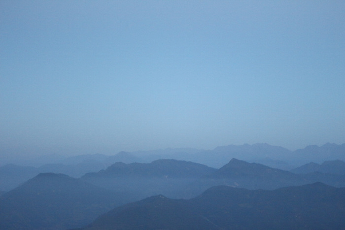 Layers of mountains sitting on the horizon in Nepal. Photo by Joan Vinson.