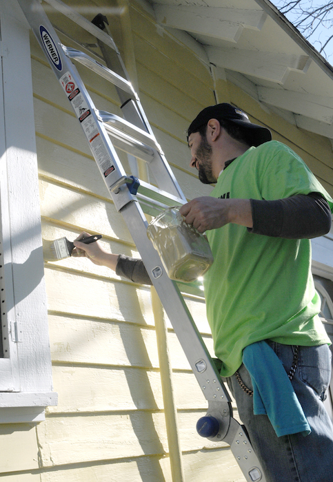 Jose Medellin get to work at the EastPoint Shine Paint-A-Thon (Photo by Kristian Jaime Photography)