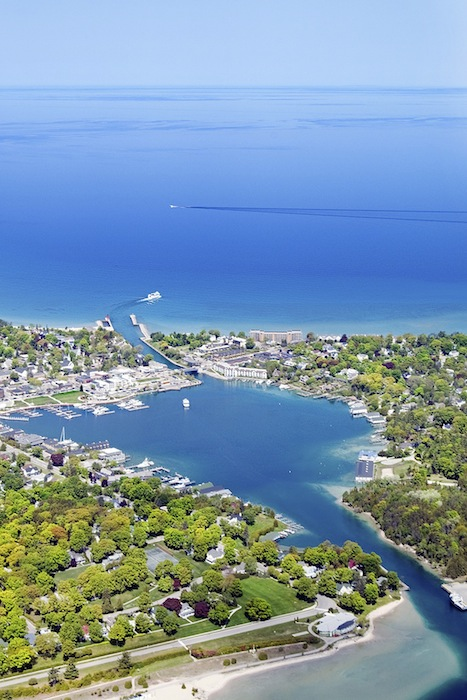 Downtown Charlevoix with Round Lake in the foreground, leading out to Lake Michigan. Photo by Kim Way.