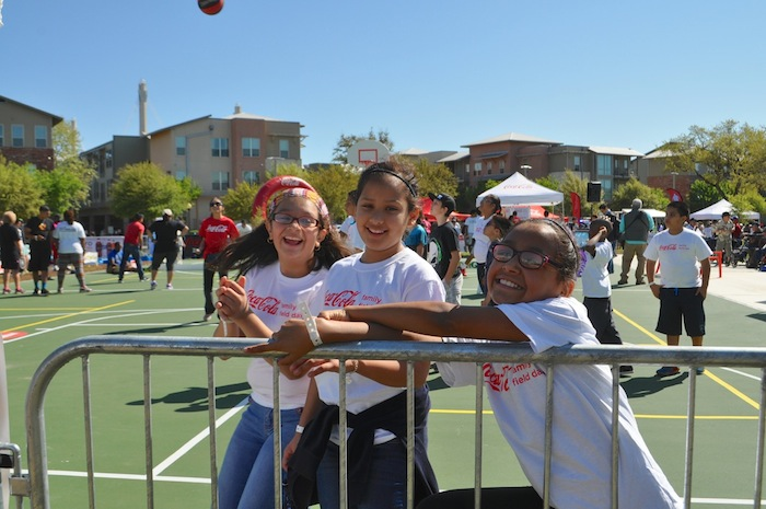 A playful group of girls pose for the camera during the Labor Street Park grand opening. Photo by Iris Dimmick.
