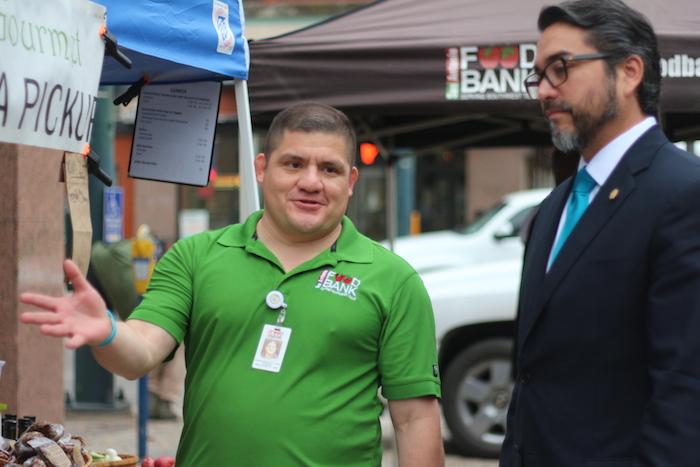San Antonio Food Bank Nutritionist John Velasquez showed Councilmember Roberto Treviño (D1) around the market on Tuesday. Photo by Joan Vinson.