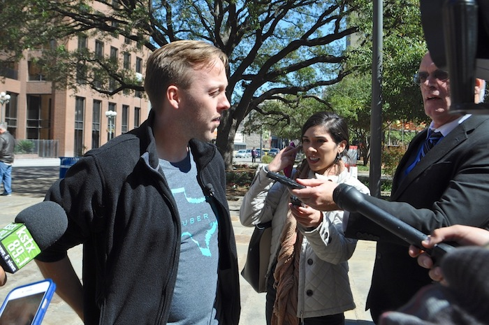 Chris Nakutis, Uber Texas general manager, speaks to media after City Council approved revisions to the TNC ordinance. Uber plans to leave San Antonio regardless. Photo by Iris Dimmick.