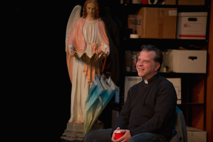 """Father Kevin Shaunessy, played by actor Rick Frederick in the """"Irish Curse"""" at the Tobin Center. Photo by Siggi Ragnar."""
