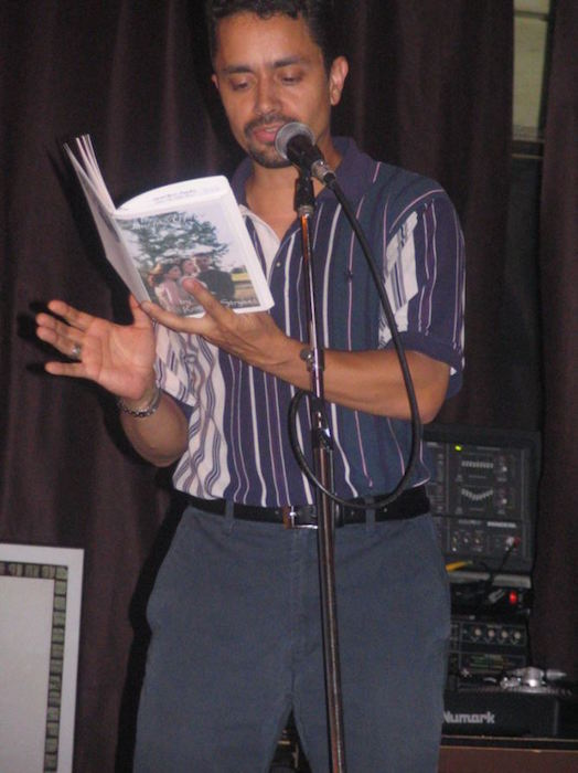 """Rod Stryker was the founder of the Sun Poet's Society in 1995. He is the author of two books and is a promoter of the spoken word. Here he reads from his book, """"Lucid Affairs."""" Photo by Rod Stryker."""